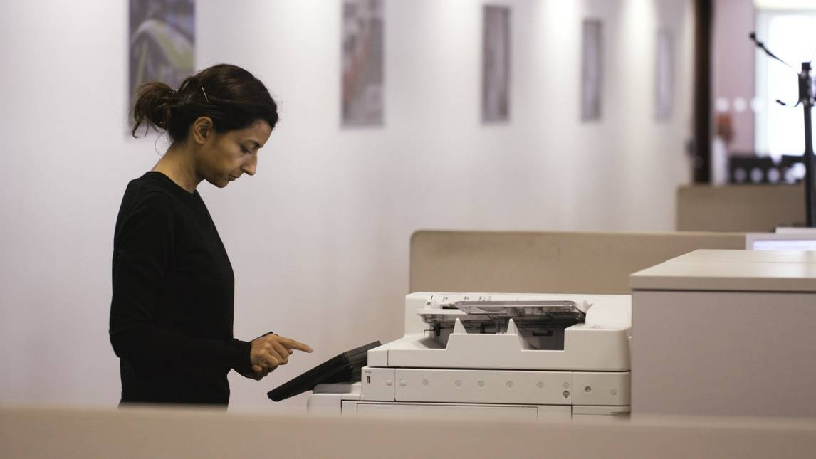 Woman using Canon multi-functional printer