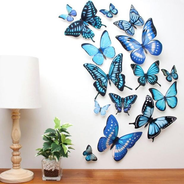 A wall decorated with blue butterflies.