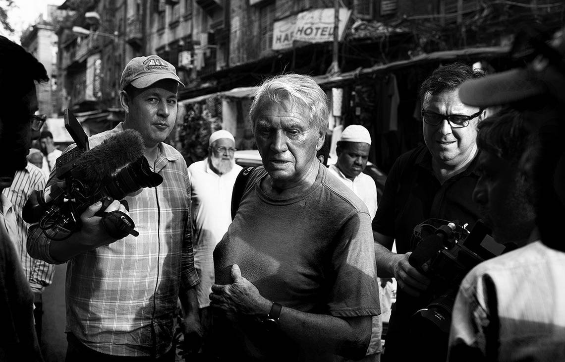 "Sir Don McCullin works through the crowds with cinematographer Chris Clarke (left): ""We had to be quick on our toes, because of the fast pace of where we were shooting,"" says Chris. ""These environments were either really cramped, or places that were quite open but crowded with thousands of people.""  © Lance Miller"