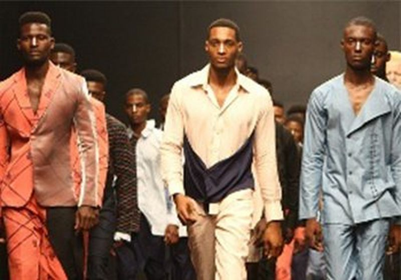 Male models walk down the runway in lines