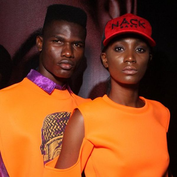 A male and female model, dressed in orange, side by side