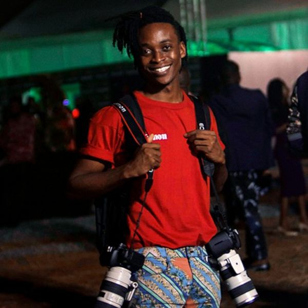 Young man with cameras over his shoulders