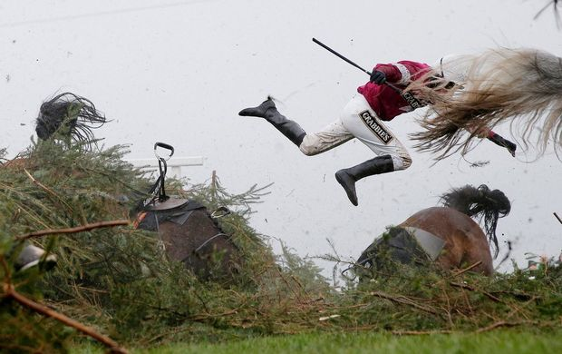 Jockey Nina Carberry flies off her horse Sir Des Champs (left) as they fall at The Chair fence during the Grand National steeplechase, at Aintree Racecourse, Liverpool, UK. Taken on a Canon EOS-1D X with an EF24-70mm f/2.8L II USM lens at 70mm; the exposure was 1/5312sec at f/4, ISO 2000.