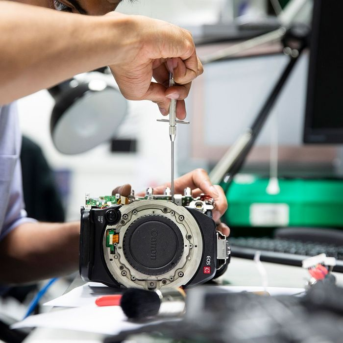 A specialist working on a Canon EOS C body