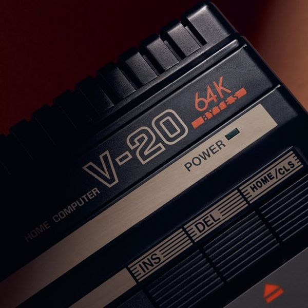 A close up of the Canon V-20 home computer, showing the text 'HOME COMPUTER V-20 65K', the power indicator and F keys.