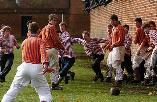 young men play Eton wall game