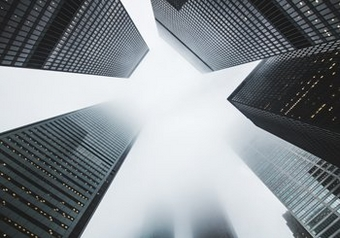 Multiple skyscrapers photographed from the ground.