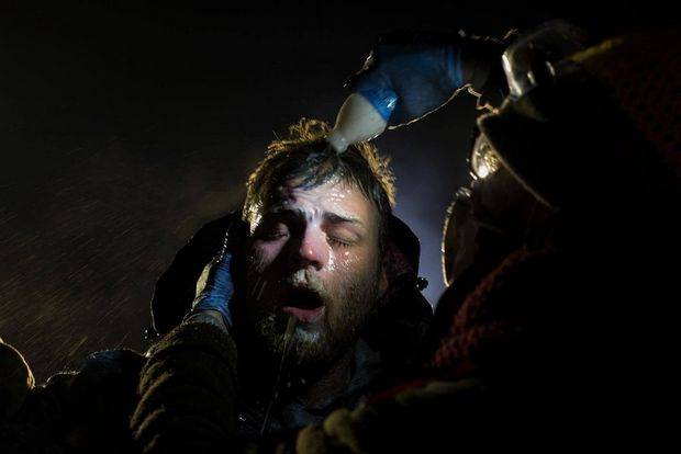 A man is treated after being pepper sprayed by police.