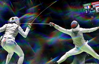 people engaging in fencing challenge