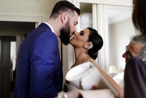 Behind the scenes at Romanian wedding - Bride and Groom kissing - taken with a EOS 5D Mark IV