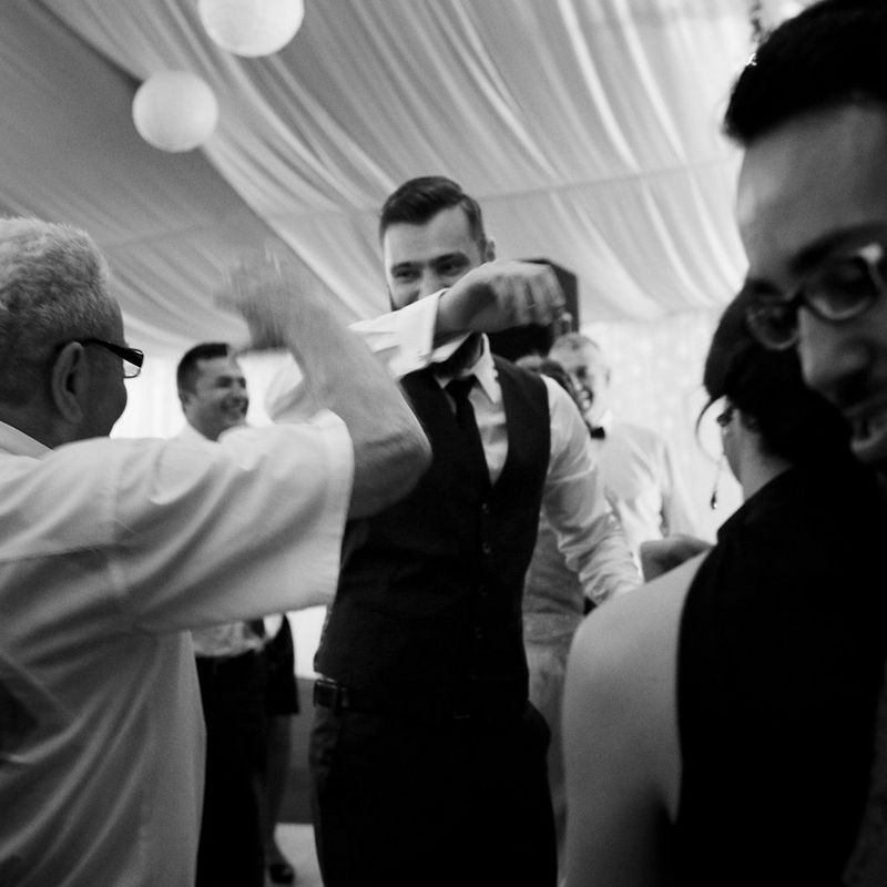 Scenes at Romanian wedding - Groom Dancing B&W Image - taken with a EOS 5D Mark IV