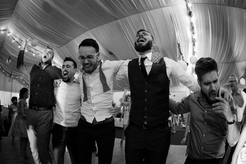 Behind the scenes at Romanian wedding - Groom and friends dancing B&W Image - taken with a EOS 5D Mark IV