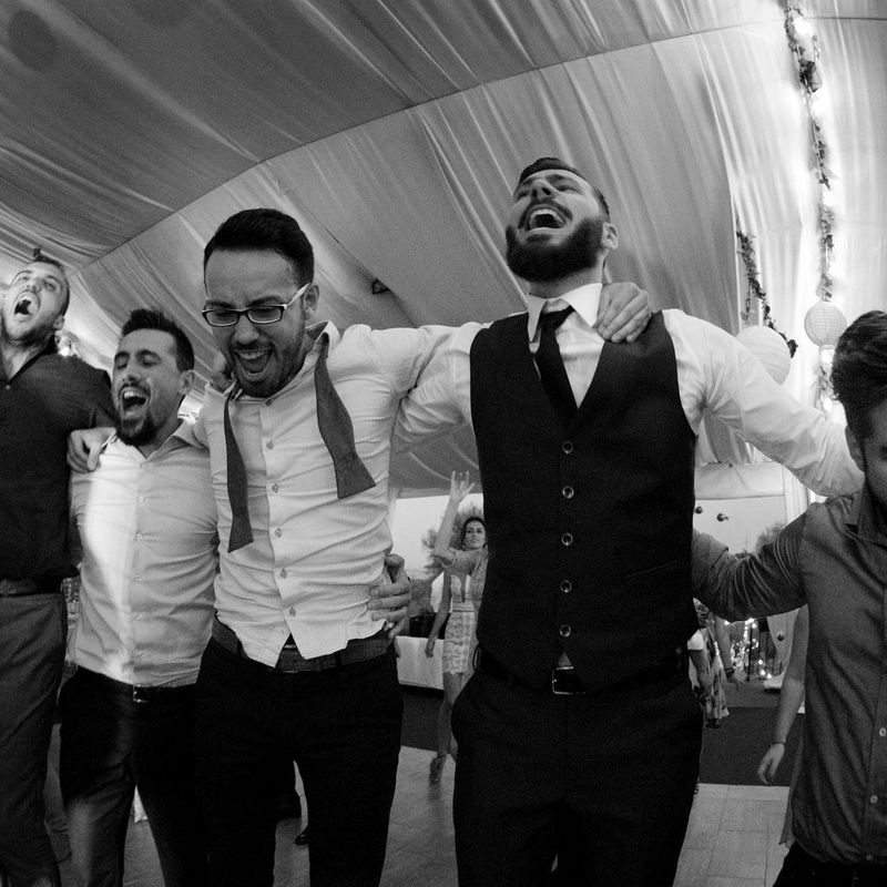 Scenes at Romanian wedding - Groom and friends dancing - taken with a EOS 5D Mark IV