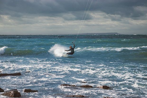 wide shot of kitesurfer