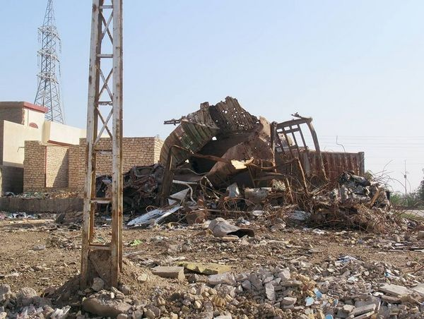 A photograph of a collapsed building, due the the conflict within Iraq.