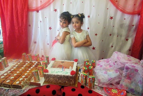 An image of a little girls' birthday party, celebrating with friends and cake.