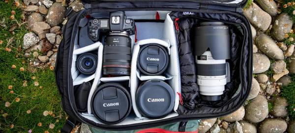 Canon Ambassador Richard Walch's kitbag, containing Canon cameras and five lenses.