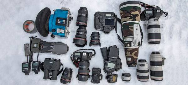 Audun Rikarden's kitbag containing Canon cameras and lenses.
