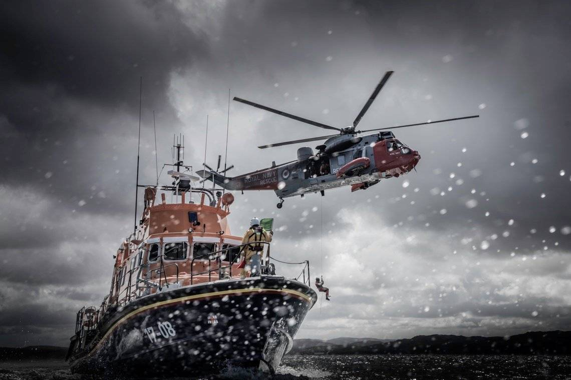 A Royal Navy helicopter and a Royal National Lifeboat Institution boat at sea, photographed by Clive Booth on a Canon EOS 5DS R.