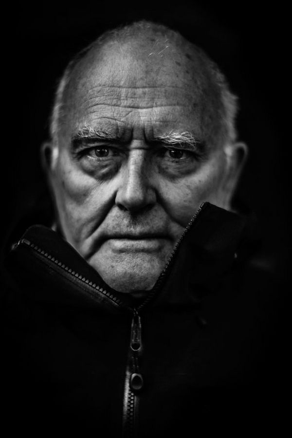 A black and white portrait of mountaineer, photographer and filmmaker John Cleare at 80. Photo by Clive Booth on a Canon EOS-1D X.