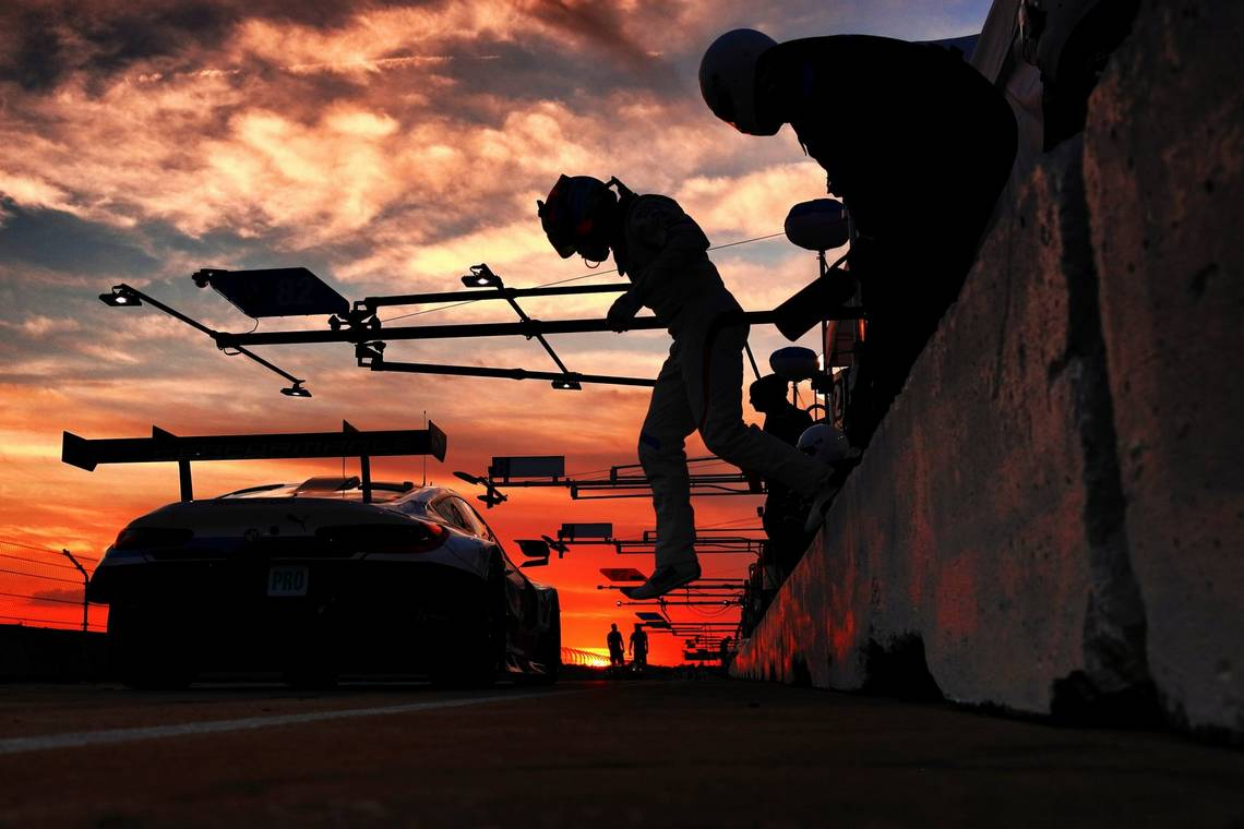 A racing driver silhouetted against the sunset jumps off a wall ready for the changeover at Sebring Raceway in Florida. Taken by Canon Ambassador Frits van Eldik on a Canon EOS R.