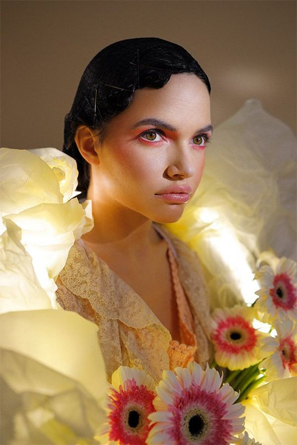 A model was a large paper garland with lights and flowers tucked into it. Photo by Guia Besana on a Canon EOS R.