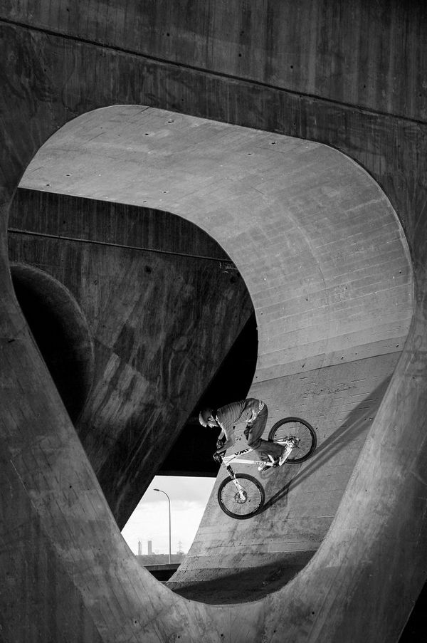 A BMX rider cycles through the supports of a bridge in Madrid, Spain, taken by Canon Ambassador Jaime de Diego on a Canon EOS-1D Mark II.