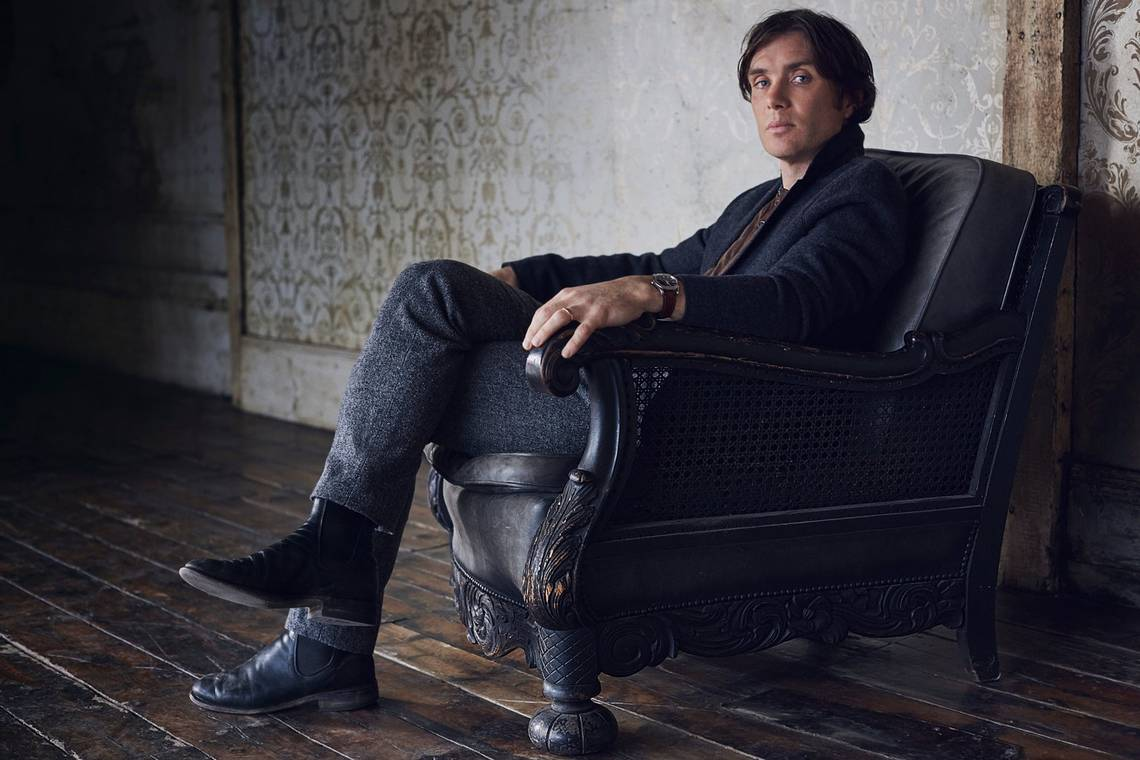 Actor Cillian Murphy sits in an armchair, looking at the camera, in a portrait by Lorenzo Agius.