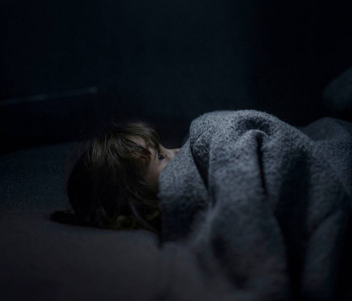 A young Jordanian girl tries to sleep in a refugee camp in Azraq, Jordan. Photo by Canon Ambassador Magnus Wennman.