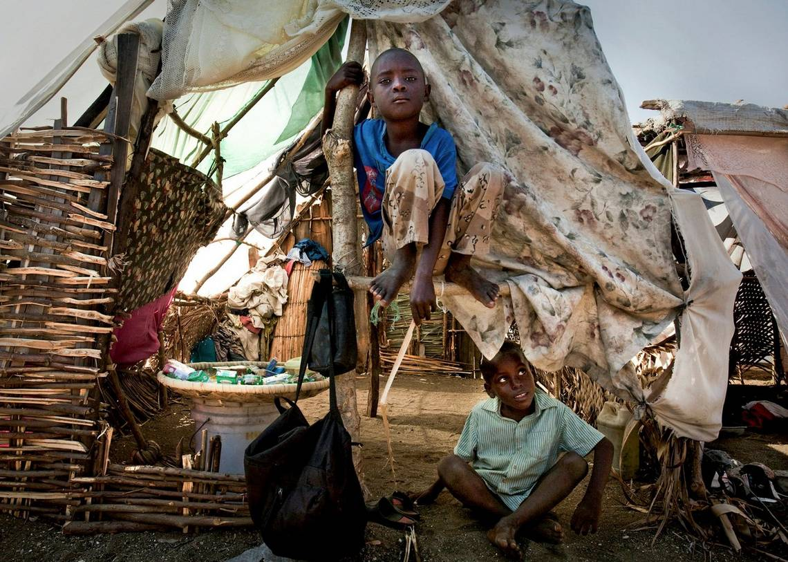 Children in a makeshift tent in a village near Léogâne, a coastal community destroyed by the 2010 earthquake in Haiti. Photo by Canon Ambassador Mashid Mohadjerin.