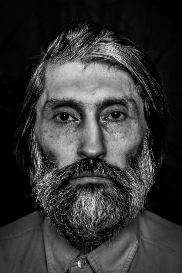 A black-and-white portrait of a homeless Russian man, photographed by Pavel Volkov on a Canon EOS 5D Mark II.