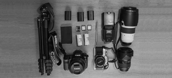 Canon Ambassador Sarah Waiswa's kitbag, containing Canon cameras, lenses and accessories.