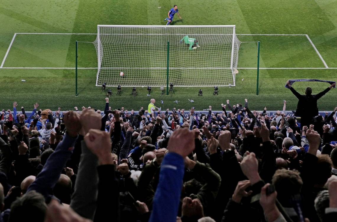 Leicester City score a goal during the 2015-2016 Premiere League, taken from behind the goal by photographer Tom Jenkins on a Canon EOS 5D Mark III.