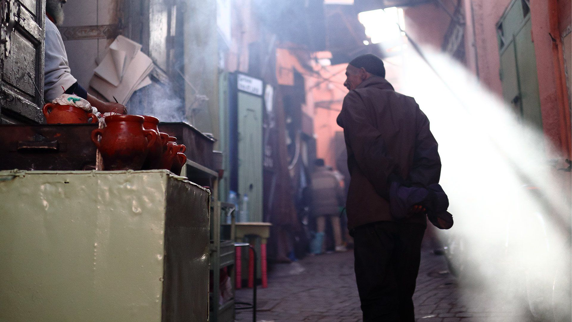 Moroccan man in alley shot using Canon EF-M 32mm f/1.4 STM