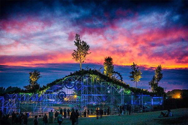 Sun sets above a huge festival display. Photo by Bart Heemskerk.