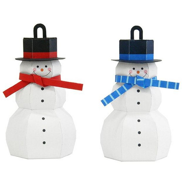 Two homemade cardboard snowman decorations, one with a blue scarf and one with red.