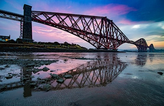 bridge silhouette over purple sky