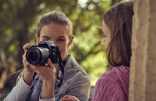 A mother and daughter pictured with a camera