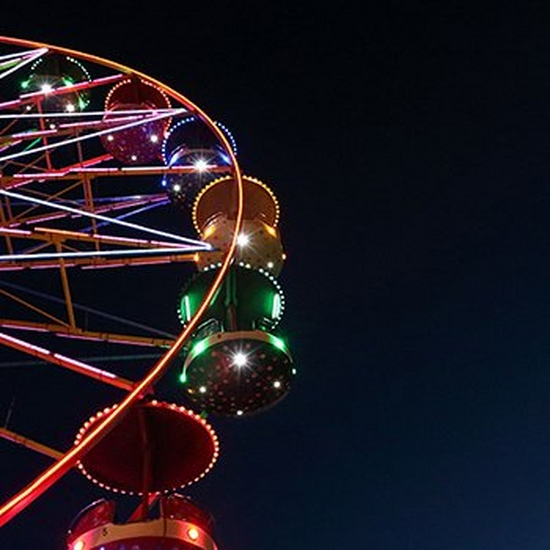 A ferris wheel illuminated against the night sky.