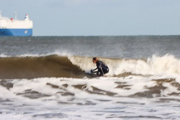 A zoomed-in shot of a surfer blurred by camera shake