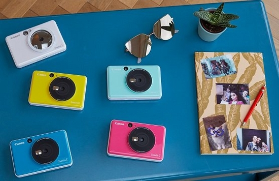 Five colourful Canon Zoemini instant cameras.