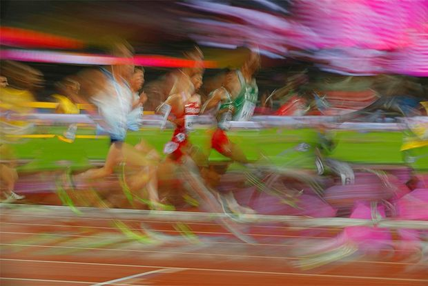 An image demonstrating motion blur of men running. Photo by Tom Jenkins.