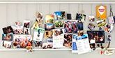Printed photos, invitations and flyers on a pin board.