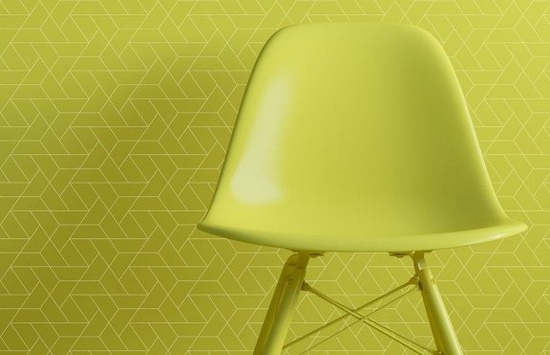 Lime green chair in front of lime green wallpaper