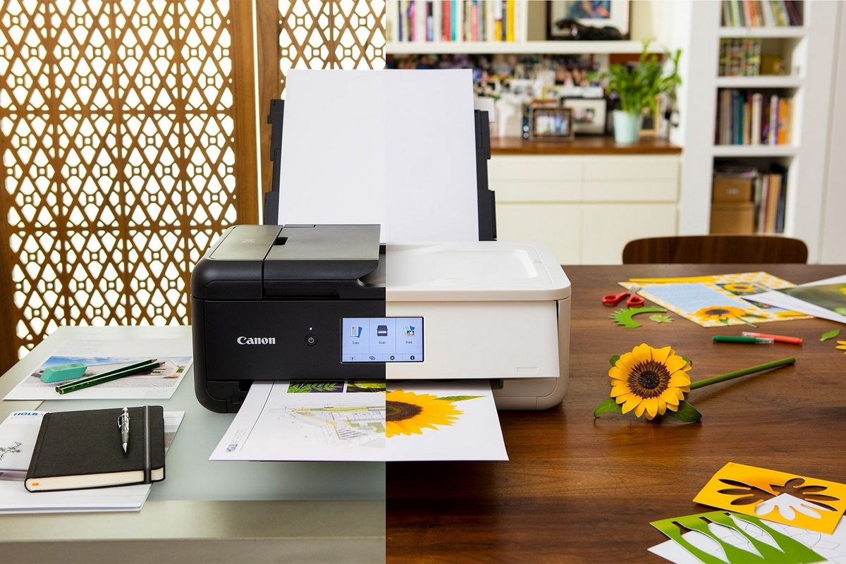The Canon PIXMA TS9550 and TS9551C on a desk or table