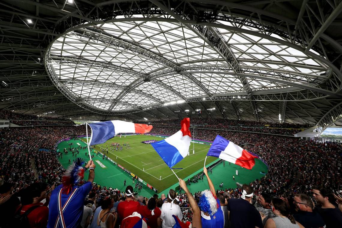 Fans wave French flags at the Wales v France quarter final match in the Oita Stadium. Taken on a Canon EOS-1D X Mark II.
