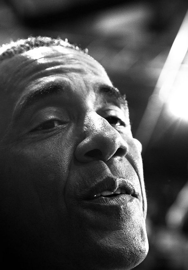 Obama is captured in extreme close-up while talking to a crowd member at one of his rallies.