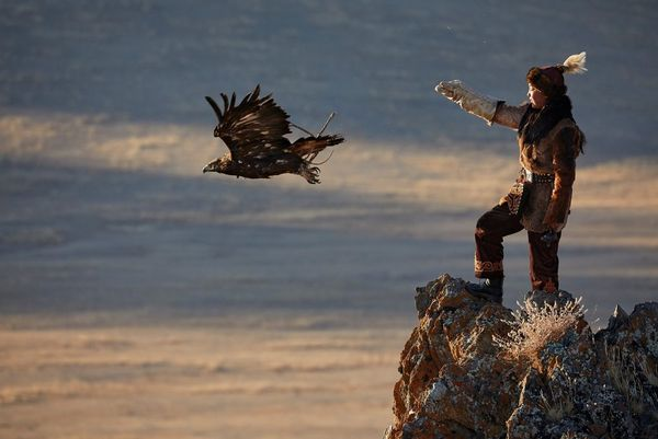 A teenage Mongolian eagle huntress releases her bird of prey. Taken by Alessandra Meniconzi on a Canon EOS 5D Mark IV.