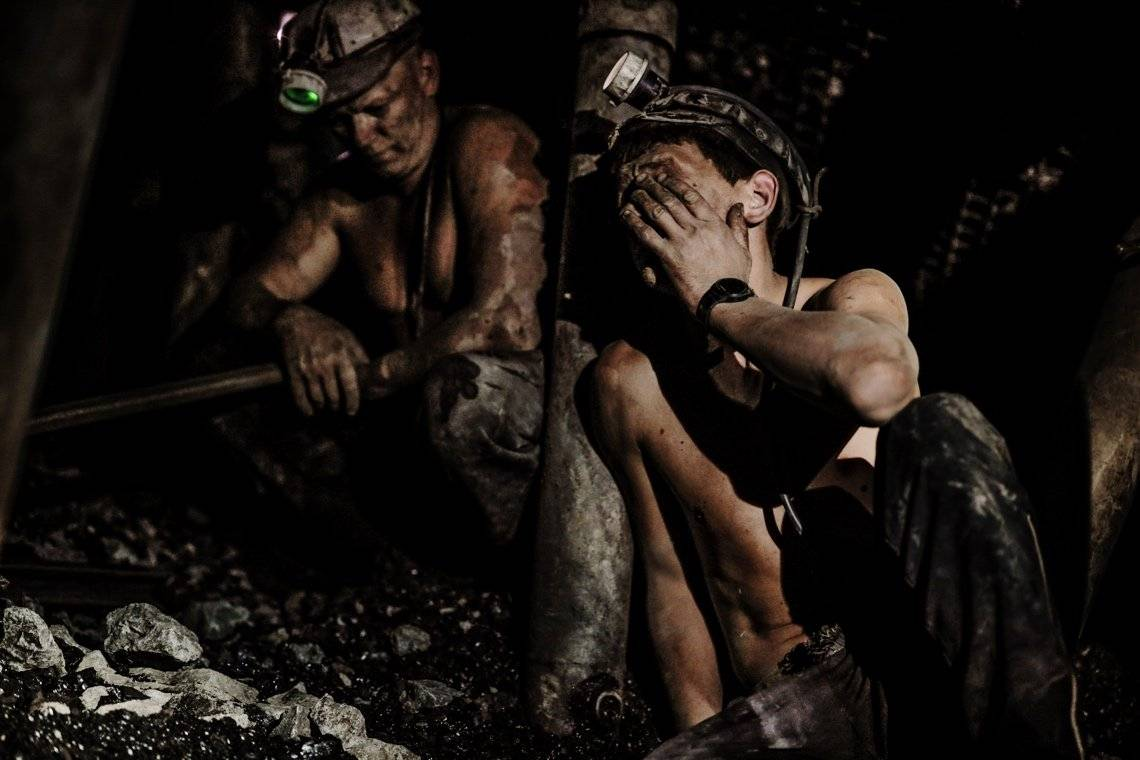 Two miners resting in a mineshaft, photographed by Daniel Etter on a Canon EOS R.