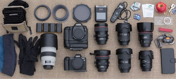 David Noton's kitbag laid out, with a Canon EOS 5DS R body, EOS R body, a selection of lenses and other equipment.